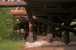 pigtail bridge piers, pier caps and under deck, wooden bridge, iron mountain road