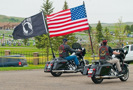 The biker parade in to the Memorial Day 2014 event was lead by the American and POW flags.